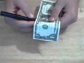 Lật tẩy trò ảo thuật chiếc bút đâm xuyên qua đồng tiền