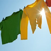 Mẹo giặt và phơi quần áo nhanh khô khi trời mưa ẩm