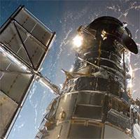 Vừa hoạt động trở lại, kính viễn vọng không gian Hubble đã chụp được ảnh hai thiên hà va vào nhau